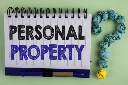 Writing note showing  Personal Property. Business photo showcasing Belongings possessions assets private individual owner written Notebook the plain background Pen next to it Ask for.