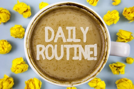 Conceptual hand writing showing Daily Routine Motivational Call. Business photo text Everyday good habits to bring changes written Coffee in Cup within Paper Balls plain background.