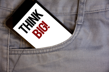 Writing note showing  Think Big Motivational Call. Business photo showcasing Have great ideas Dream of something amazingConcept on cell phone on jean pocket white screen black and red letters