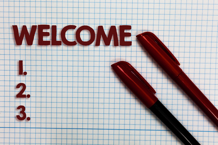 Conceptual hand writing showing Welcome. Business photo showcasing Warm salutation acknowledgement for someone amiable loved thanked Graph paper ideas important marker pens practical book jobs