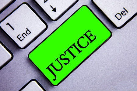 Handwriting text writing Justice. Concept meaning Quality of being just impartial or fair Administration of law rules Keyboard green key Intention create text computer paper essay inspiration