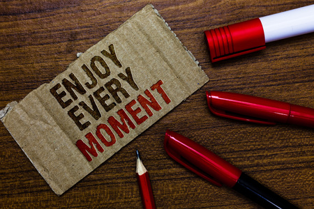 Word writing text Enjoy Every Moment. Business concept for being pleased with your life Have fun Precious time Pen pencil cap board marker pointer text cardboard notice script idea