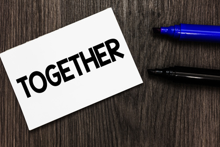 Text sign showing Together. Conceptual photo In proximity,union or collison with another person or things Important idea ideas notebook marker markers wooden background reminder