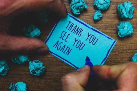 Photo pour Writing note showing Thank You See You Again. Business photo showcasing Appreciation Gratitude Thanks I will be back soon Foggy hand hold marker drawn blue notepad paper lump on wooden floor - image libre de droit