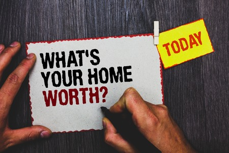Foto für Handwriting text writing What s is Your Home Worth question. Concept meaning Value of a house Property Cost Price Rate Hand grip black marker writing text paperclip stick written page woody deck - Lizenzfreies Bild