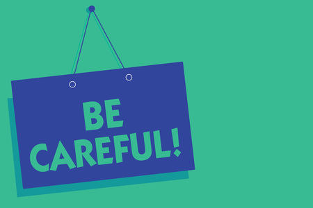 Writing note showing Be Careful. Business photo showcasing making sure of avoiding potential danger mishap or harm Blue board wall message communication open close sign green background
