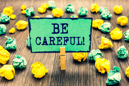 Text sign showing Be Careful. Conceptual photo making sure of avoiding potential danger mishap or harm Clothespin holding green note paper crumpled papers several tries mistakes