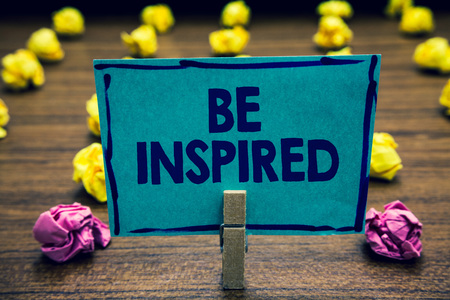 Photo for Text sign showing Be Inspired. Conceptual photo extraordinary quality as arising from some creative impulse Clothespin holding blue paper note crumpled papers several tries mistakes - Royalty Free Image