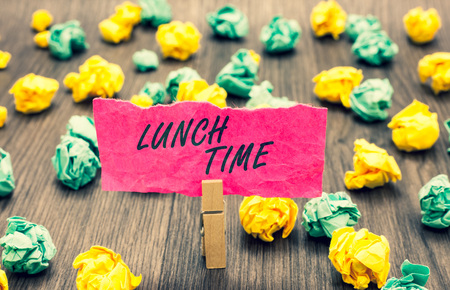 Writing note showing Lunch Time. Business photo showcasing Meal in the middle of the day after breakfast and before dinner Clothespin holding pink note paper crumpled papers several tries