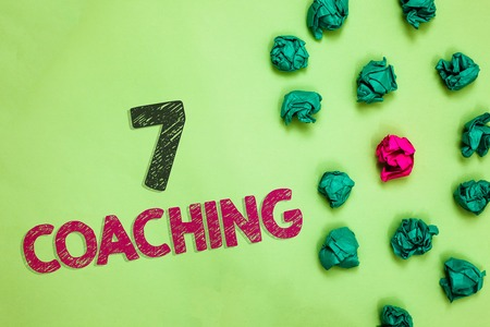 Text sign showing 7 Coaching. Conceptual photo Refers to a number of figures regarding business to be succesful Crumpled wrinkled papers one different pink unique special green background
