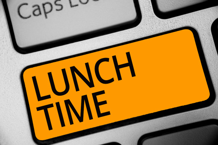 Conceptual hand writing showing Lunch Time. Business photo showcasing Meal in the middle of the day after breakfast and before dinner Keyboard orange key computer computing reflection document