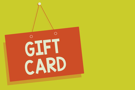 Red board with message saying Gift Card on yellow background