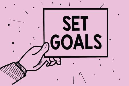 Word writing text Set Goals. Business concept for Defining or achieving something in the future based on plan Man hand holding paper communicating information dotted purple background