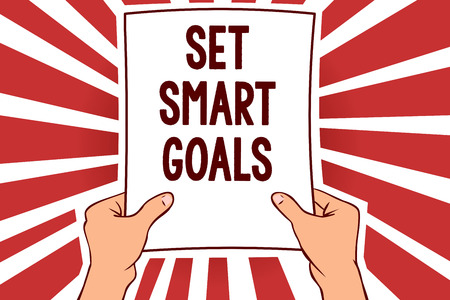 Handwriting text writing Set Smart Goals. Concept meaning Establish achievable objectives Make good business plans Man holding paper important message remarkable red rays enlighten ideas