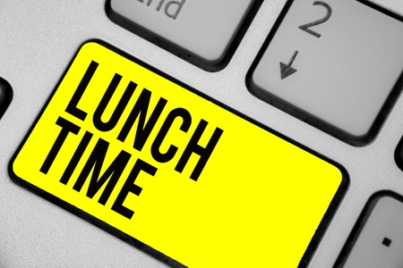 Word writing text Lunch Time. Business concept for Meal in the middle of the day after breakfast and before dinner Keyboard yellow key Intention create computer computing reflection document