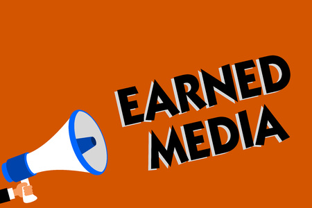 Conceptual hand writing showing Earned Media. Business photo showcasing Publicity gained through promotional efforts by multimedia Man holding loudspeaker orange background message speaking