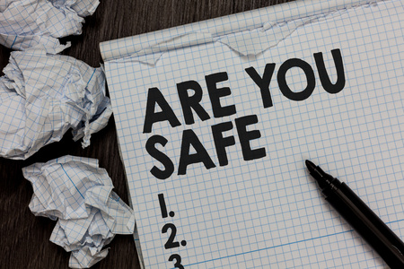 Text sign showing Are You Safe. Conceptual photo Free from danger Not anticipating any Harm Hurt physically Marker over notebook crumpled papers ripped pages several tries mistakes