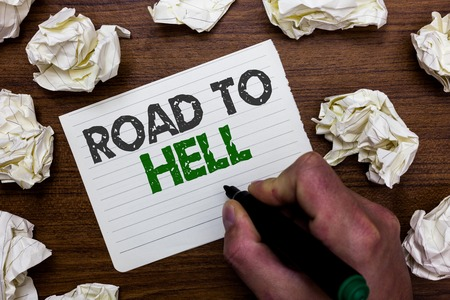 Conceptual hand writing showing Road To Hell. Business photo showcasing Extremely dangerous passageway Dark Risky Unsafe travel Man holding marker notebook page crumpled papers mistakes