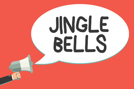 Text sign showing Jingle Bells. Conceptual photo Most famous traditional Christmas song all over the world Man holding megaphone loudspeaker speech bubble message speaking loud