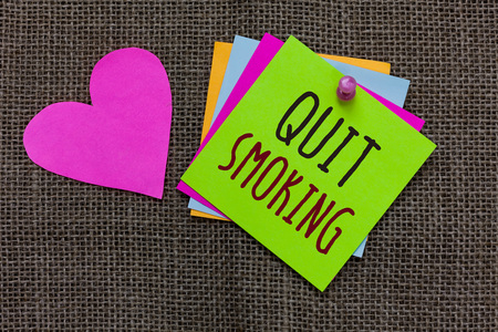 Handwriting text Quit Smoking. Concept meaning Discontinuing or stopping the use of tobacco addiction Paper notes Important reminders Romantic lovely message Jute background