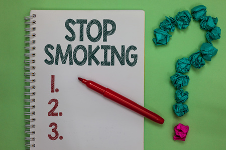 Handwriting text Stop Smoking. Concept meaning Discontinuing or stopping the use of tobacco addiction Notebook marker crumpled papers forming question mark green background