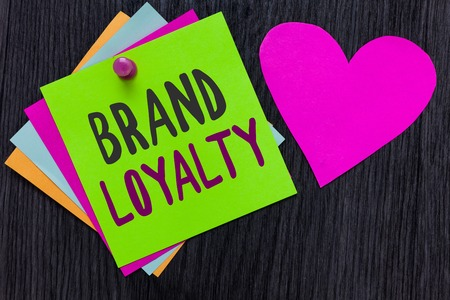 Photo pour Text sign showing Brand Loyalty. Conceptual photo Repeat Purchase Ambassador Patronage Favorite Trusted Papers Romantic lovely message Heart Good feelings Wooden background - image libre de droit