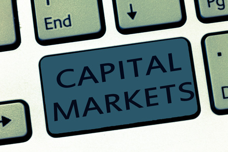 Word writing text Capital Markets. Business concept for Allow businesses to raise funds by providing market security.