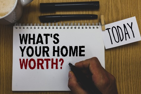 Foto für Conceptual hand writing showing What s is Your Home Worth question. Business photo text Value of a house Property Cost Price Rate Written on paper hand hold pen clipper grip sticky note black pen - Lizenzfreies Bild