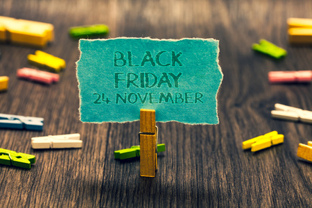 Photo pour Conceptual hand writing showing Black Friday 24 November. Business photo showcasing Special sales Thanksgiving discounts Clearance Paperclip retain blue cardboard blurry woody desk paper clip - image libre de droit