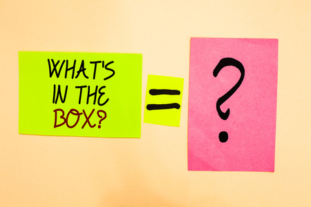 Writing note showing What s is In The Box question. Business photo showcasing Curiosity Opening a gift Surprise package Written on green sticky note on yellow and question mark on pink paper