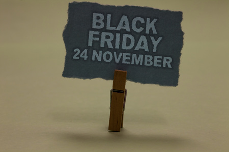 Photo pour Handwriting text writing Black Friday 24 November. Concept meaning Special sales Thanksgiving discounts Clearance Paperclip retain ash color written torn thick page on shadow ash floor - image libre de droit