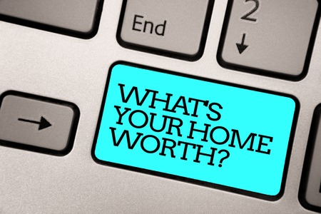 Foto für Text sign showing What s is Your Home Worth question. Conceptual photo Value of a house Property Cost Price Rate Silver grey computer keyboard with blue button black color written text - Lizenzfreies Bild