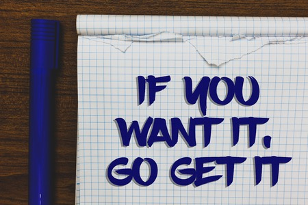 Writing note showing If You Want It, Go Get It.. Business photo showcasing Make actions to accomplish your goals wishes Written white notepad on grey wooden background beside blue marker