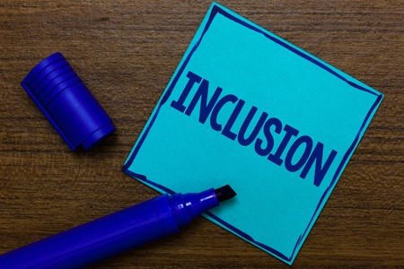 Photo pour Writing note showing Inclusion. Business photo showcasing action state including of being included within group or structure Blue Paper Important reminder Communicate ideas Wooden background - image libre de droit