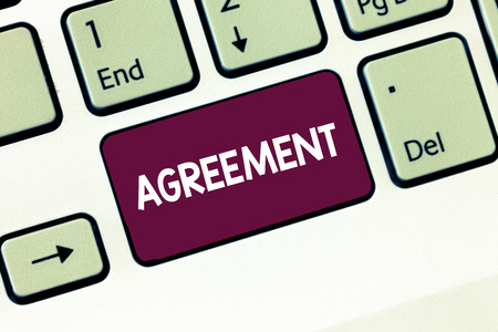 Writing note showing Agreement. Business photo showcasing harmony or accordance in opinion or feeling negotiated positively Keyboard Intention to create computer message keypad idea