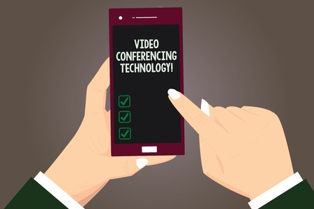 Word writing text Video Conferencing Technology. Business concept for People globally interacted through video data Hu analysis Hands Holding Pointing Touching Smartphone Blank Color Screen