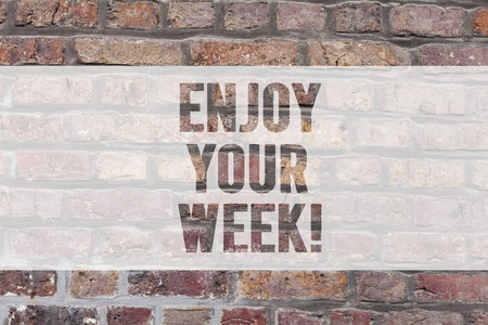 Photo for Writing note showing Enjoy Your Week. Business photo showcasing Best wishes for the start of weekdays have great days Brick Wall art like Graffiti motivational call written on the wall - Royalty Free Image