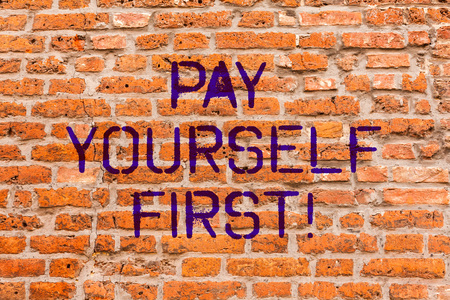 Conceptual hand writing showing Pay Yourself First. Business photo showcasing Personal Finance Save money for future Brick Wall art like Graffiti motivational written on wall