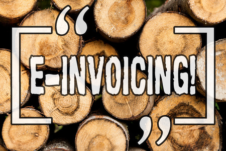 Word writing text E Invoicing. Business concept for Company encourages use of digital billing Wooden background vintage wood wild message ideas intentions thoughts