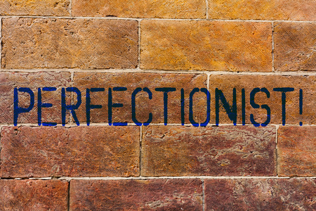 Foto de Conceptual hand writing showing Perfectionist. Concept meaning Person who wants everything to be perfect Highest standards Brick Wall art like Graffiti motivational written on wall - Imagen libre de derechos