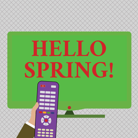 Conceptual hand writing showing Hello Spring. Concept meaning Welcoming season comes after winter Blossoming of plantes Hand Holding Remote Control infront of Wide Color PC Screen