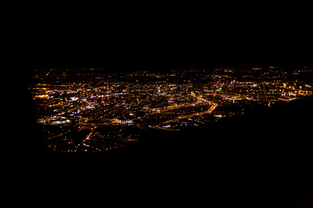 Photo for Dark background view of city with lights from aeroplane. Night lights in the city. Aeroplane view of dark nigh above the city lights - Royalty Free Image