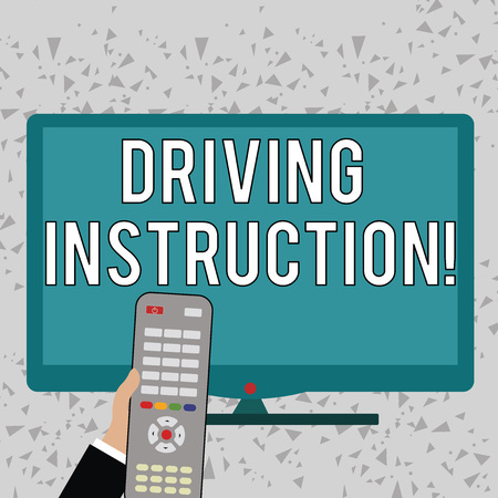 Word writing text Driving Instruction. Business photo showcasing detailed information on how driving should be done Hand Holding Computer Remote Control infront of Blank Wide Color PC Screen
