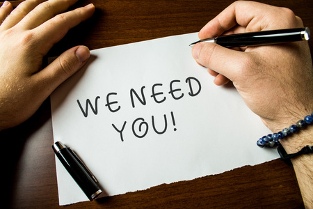 Photo pour Text sign showing We Need You. Business photo text asking someone to work together for certain job or target Close up view male hands writing blank stationary paper pens wooden table - image libre de droit