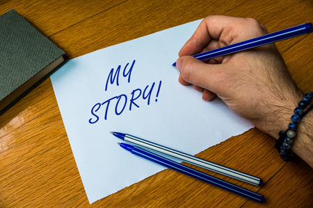 Photo pour Handwriting text writing My Story. Conceptual photo your past life events actions or choices you made Top vie male handwriting wooden desk electronic device Writing down project - image libre de droit