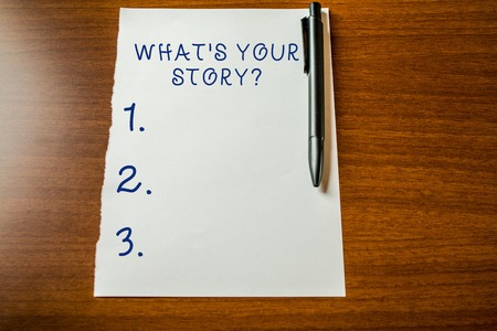 Photo pour Handwriting text What S Your Story Question. Conceptual photo asking demonstrating about his past life actions events Upper view blank stationary paper lying wooden table pen. Writing essay - image libre de droit