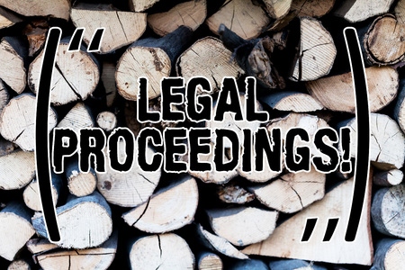 Handwriting text Legal Proceedings. Conceptual photo procedure instituted in a court of law to acquire benefit Background dry chopped firewood logs stacked up in a pile winter chimney