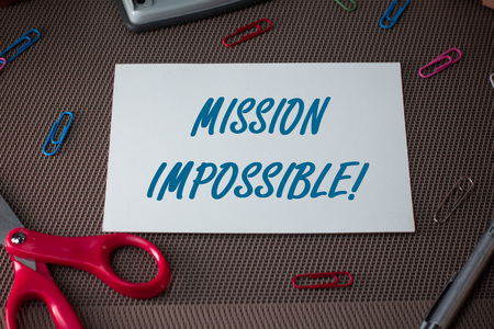Text sign showing Mission Impossible. Business photo showcasing Difficult Dangerous Assignment Isolated Unimaginable Task Scissors and writing equipments plus plain sheet above textured backdrop
