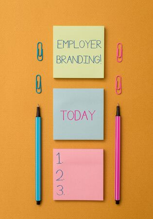 Photo pour Word writing text Employer Branding. Business photo showcasing promoting company employer choice to desired target group Front view blank colored sticky note two ballpoints clips yolk background - image libre de droit
