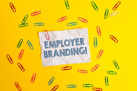 Photo pour Text sign showing Employer Branding. Business photo showcasing promoting company employer choice to desired target group Blank crushed paper sheet message clips binders plain colored background - image libre de droit